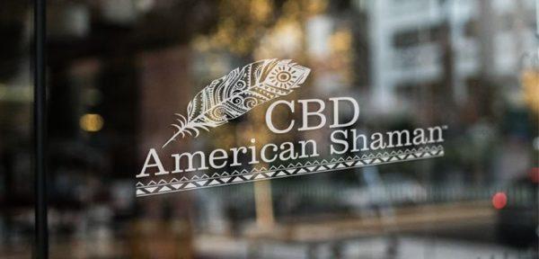 CBD American Shaman logo on glass